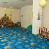 Детская комната с воспитателем